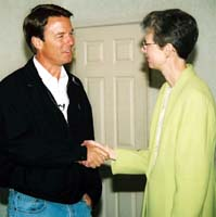 Council 222 President Carolyn Federoff shakes hands with presidential candidate John Edwards